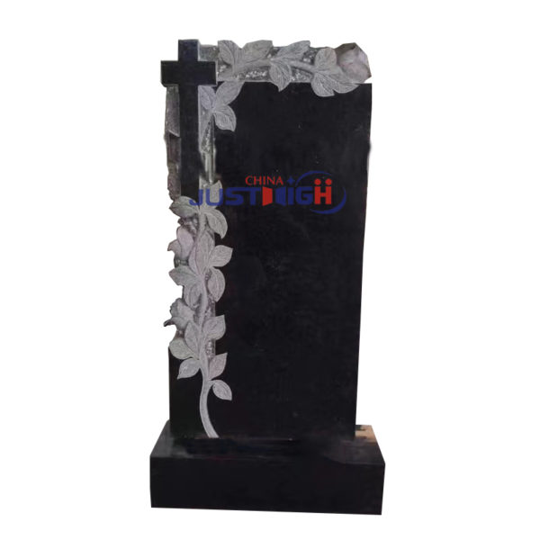 black headstone with flower and corss caving