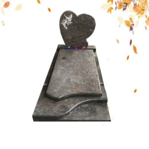 heart shape granite headstone with bird image