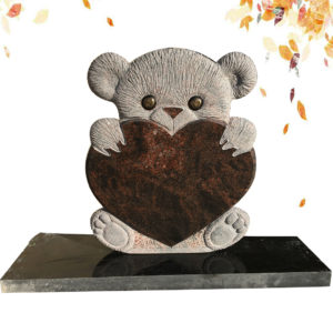 child headstone with bear statue and heart shape