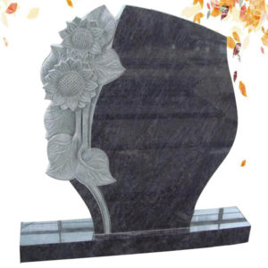 mass blue with flower carved granite headstone